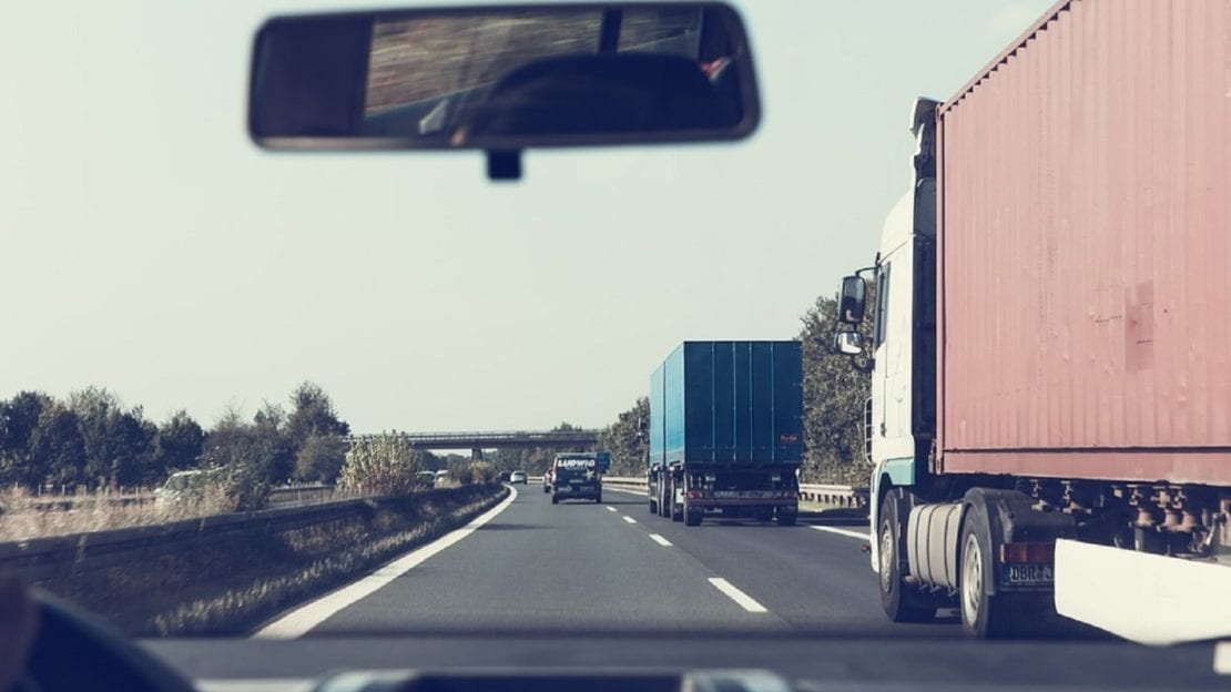 Semi Trucks Driving On The Interstate Stock Photo