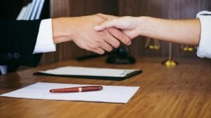 Attorney Shaking Hands With A Client Stock Photo