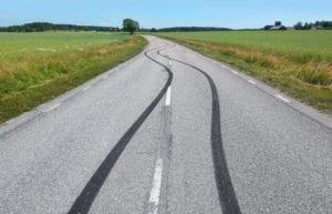 Tire print on the asphalt road