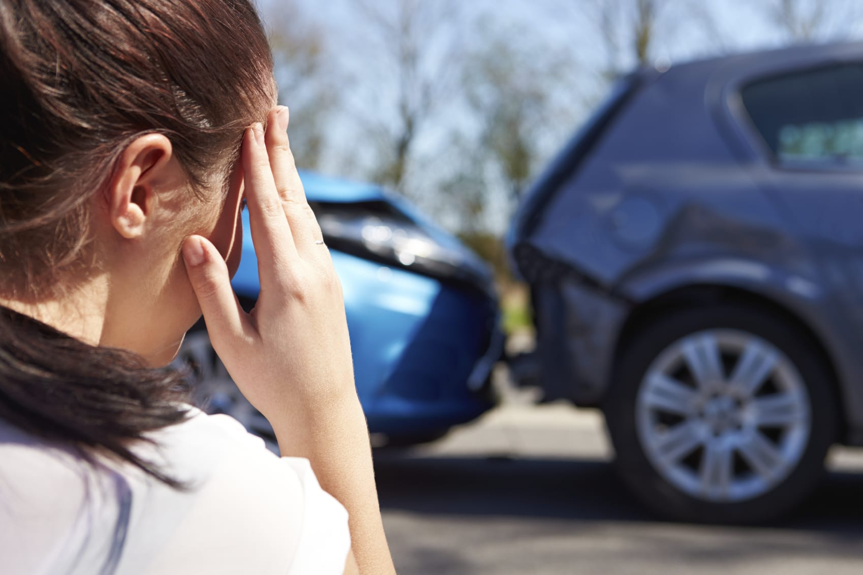 Distressed Woman Viewing Car Accident Scene Stock Photo
