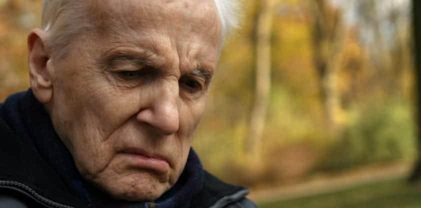 Distressed Elderly Gentleman Walking Outdoors Stock Photo