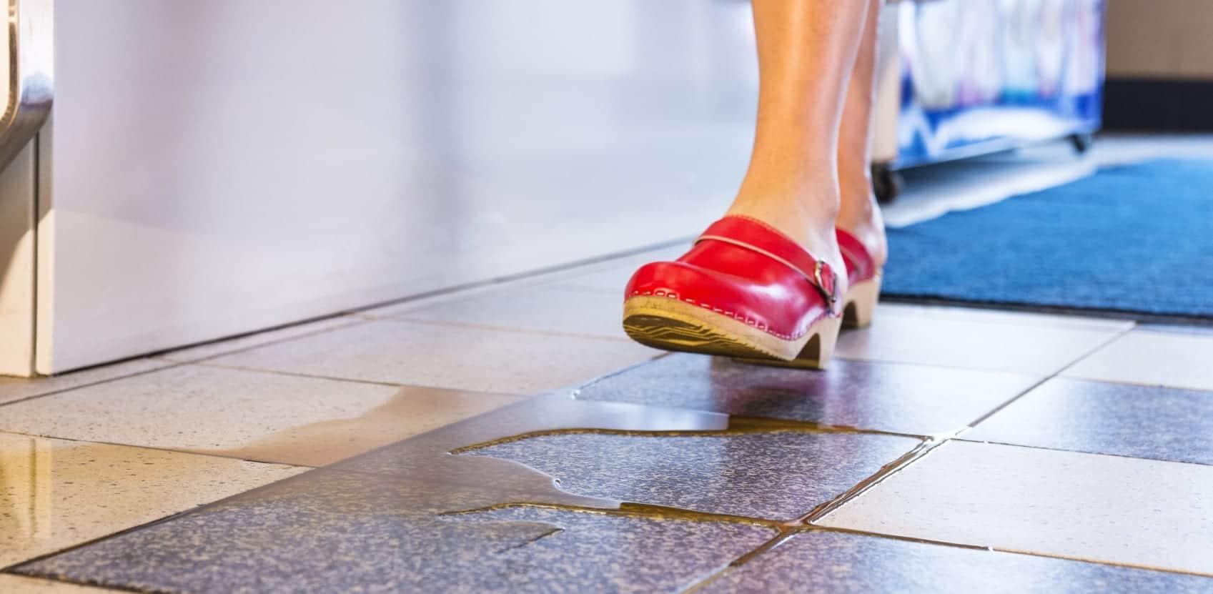 Woman Walking On Wet Floor Stock Photo