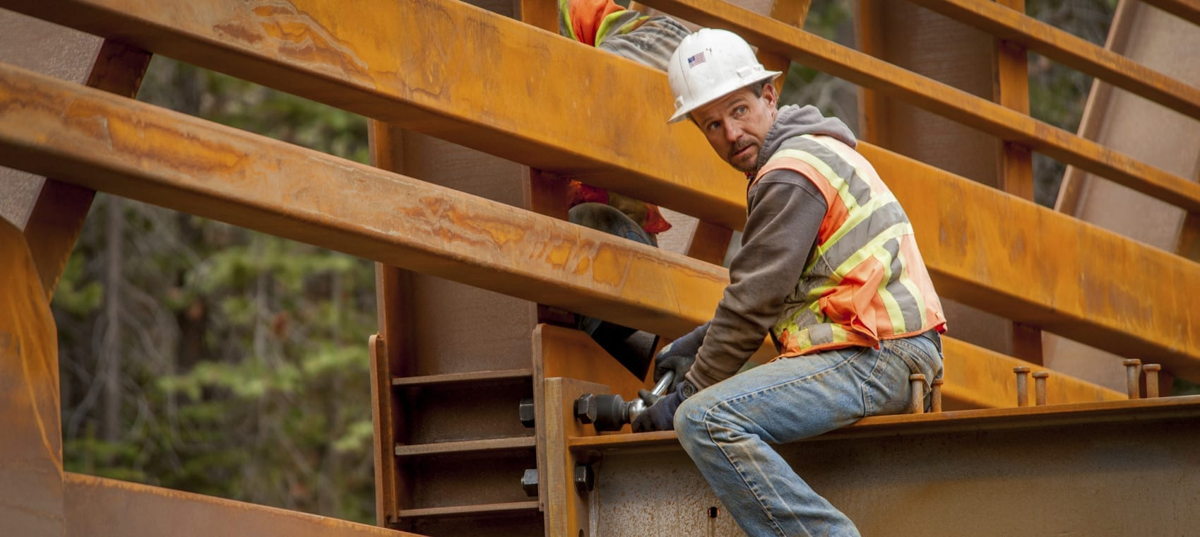 Construction Worker Working On A Bridge Stock Photo