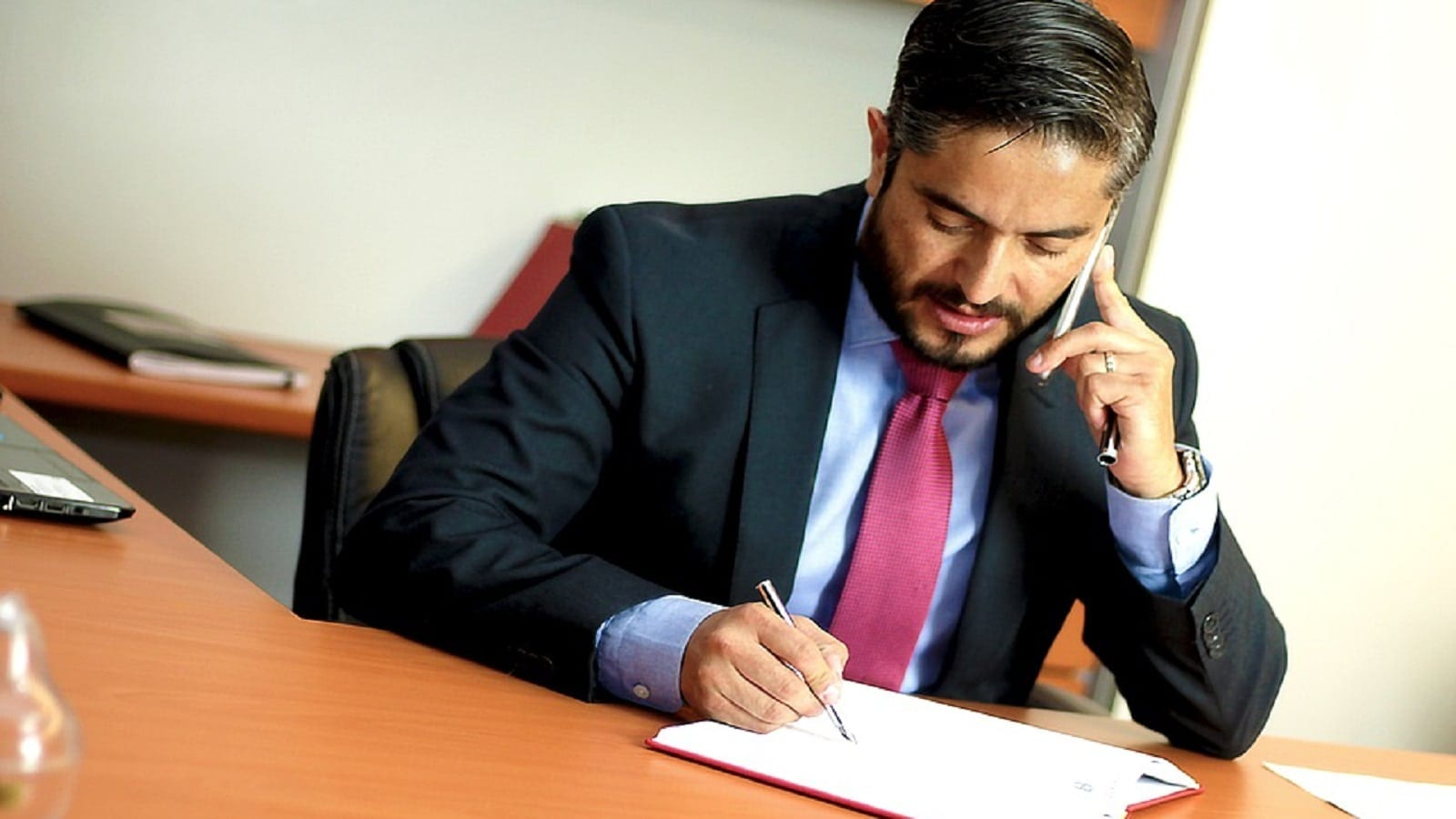 Attorney Talking On His Phone At His Desk Stock Photo