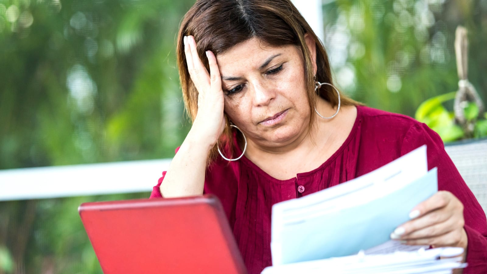 Injured Woman Reading A Denial Letter Stock Photo