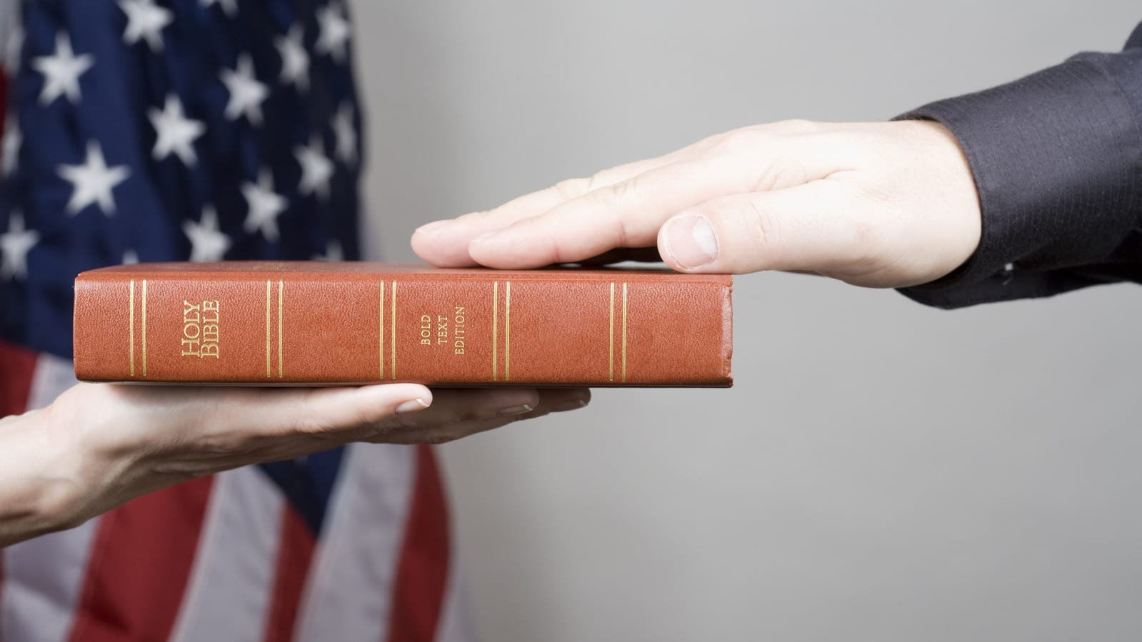 Man Swearing On A Bible Stock Photo
