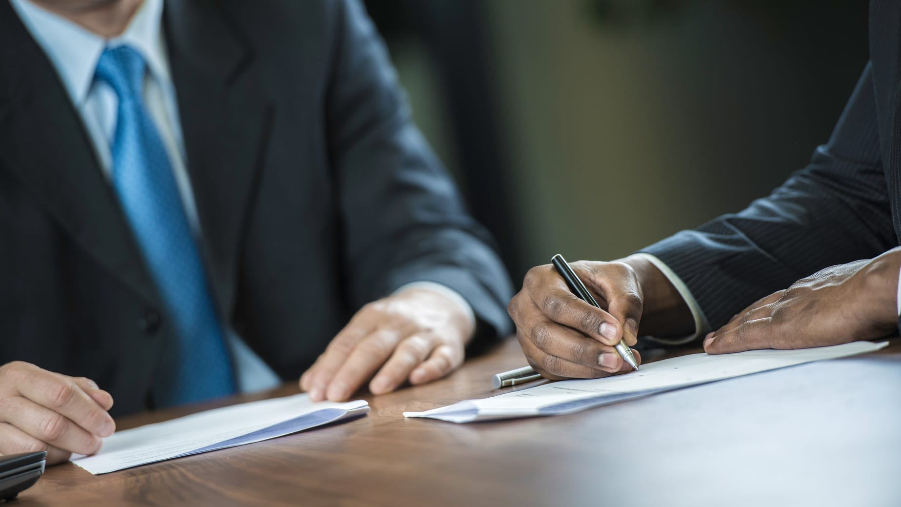 Attorney Advising Client To Sign Legal Document Stock Photo