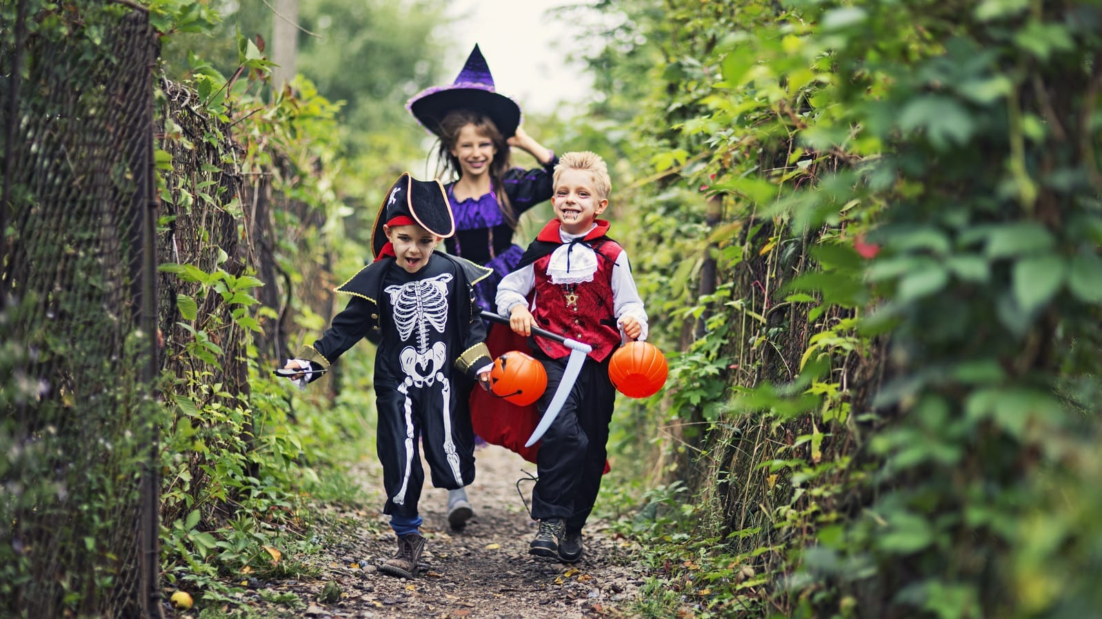 Small Children Trick Or Treating At Halloween Stock Photo
