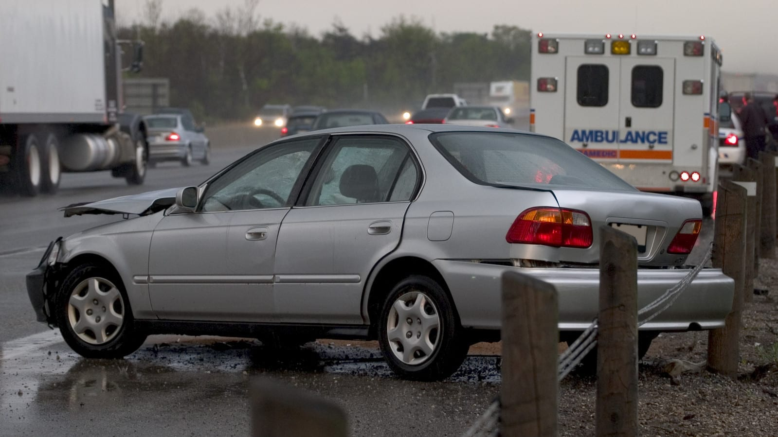 Car Accident On Highway Shoulder Stock Photo