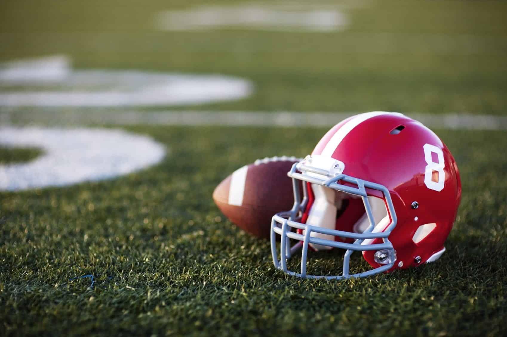Football Helmet Laying Next To A Football Stock Photo