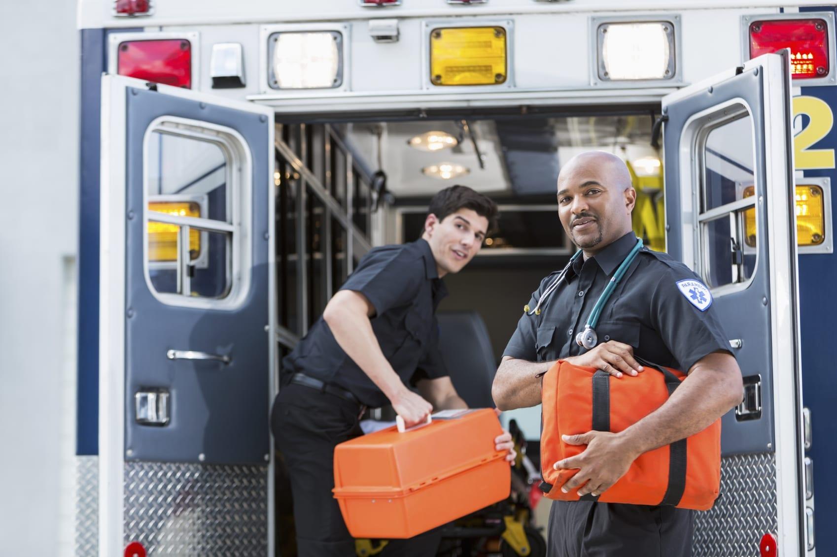Paramedics Loading An Ambulance With Supplies Stock Photo