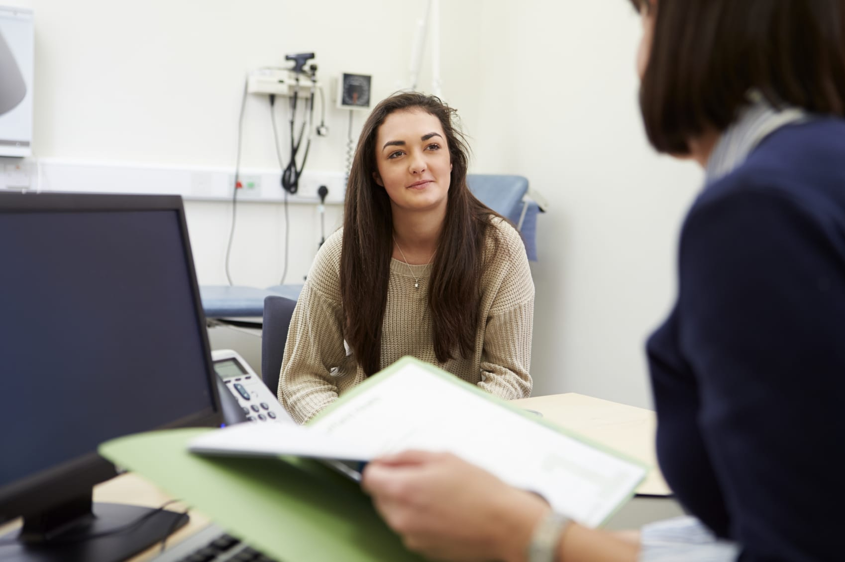 Young Female Speaking With Physician Stock Photo