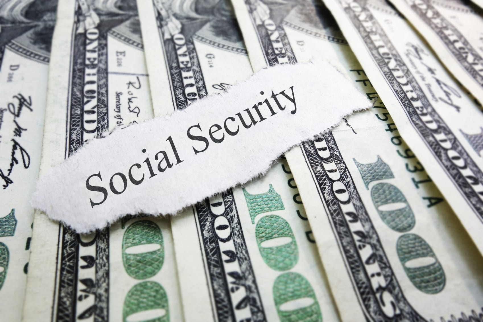 Social Security Slip On American Currency Stock Photo
