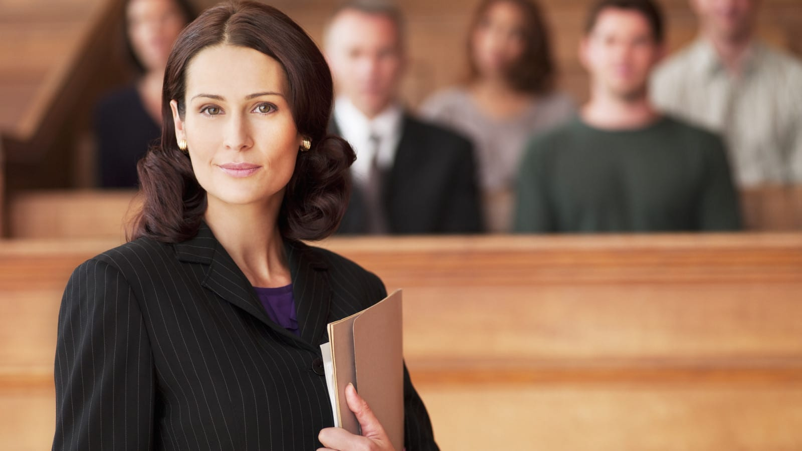 Female Attorney Standing In Front Of A Jury Stock Photo