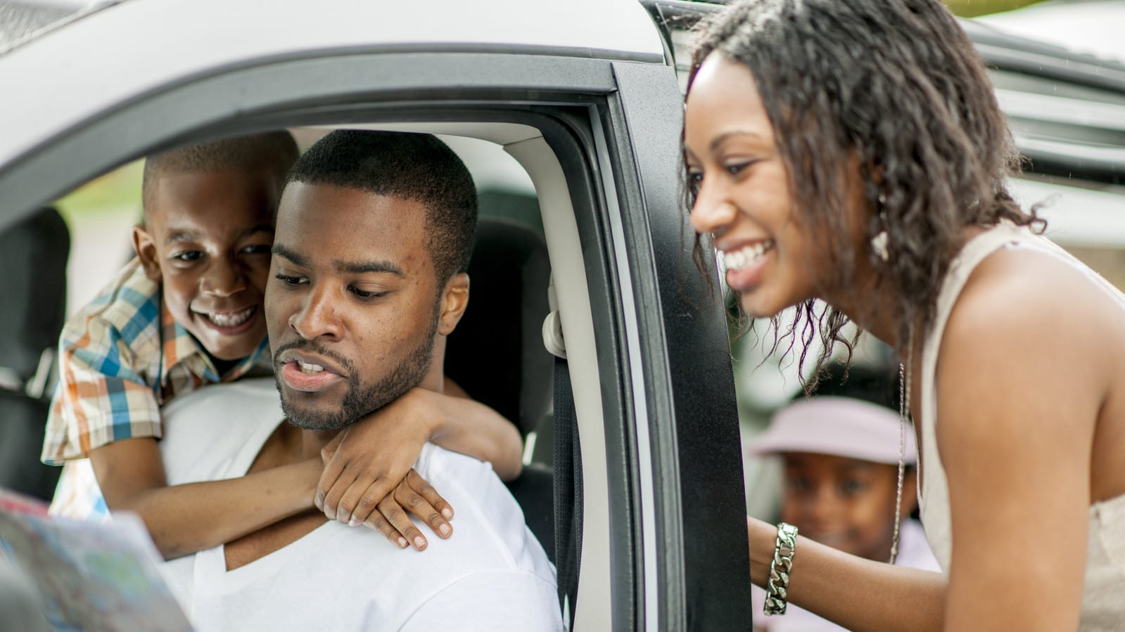 Family Preparing For Road Trip Stock Photo