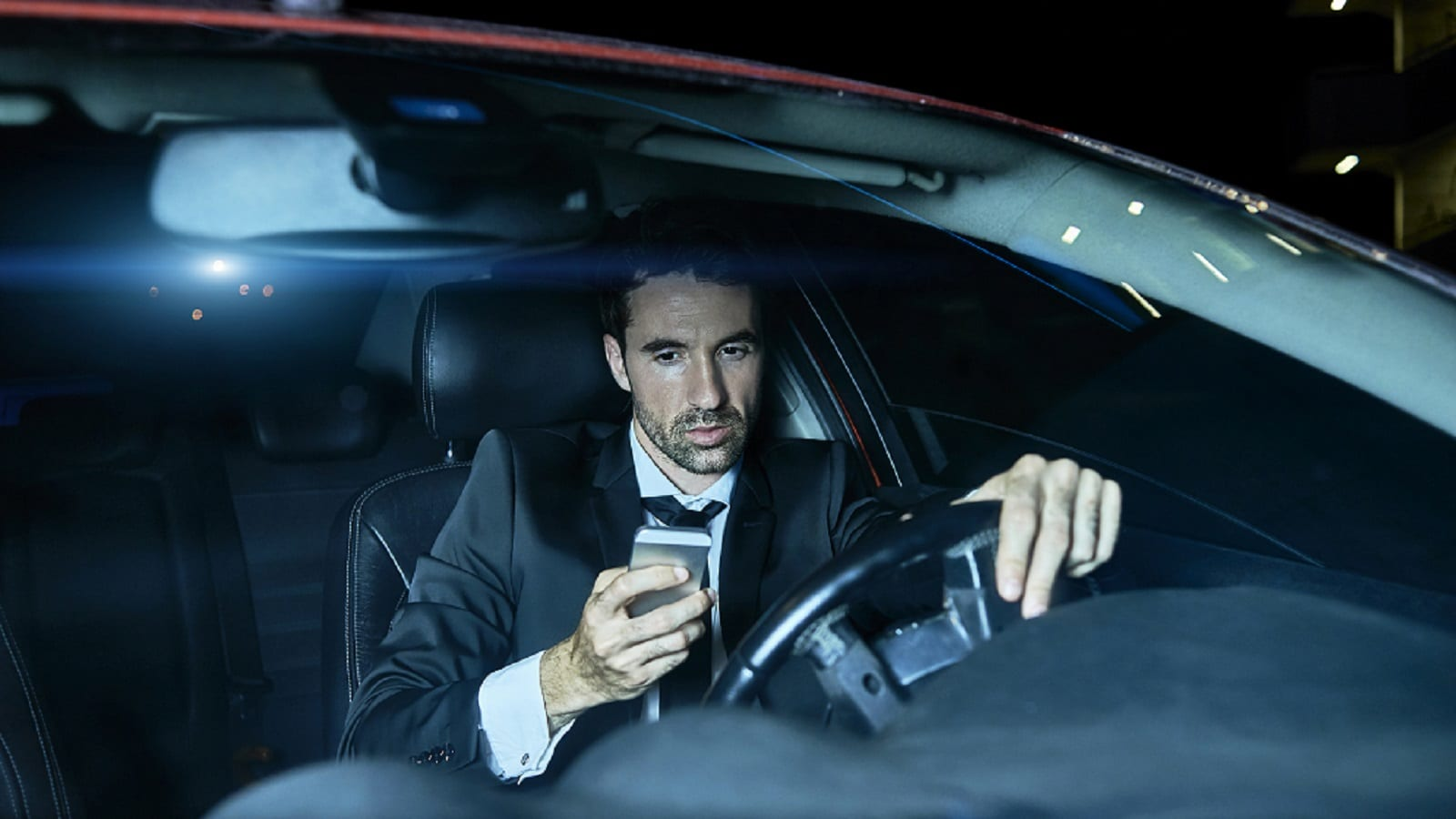 Businessman Texting While Driving Stock Photo