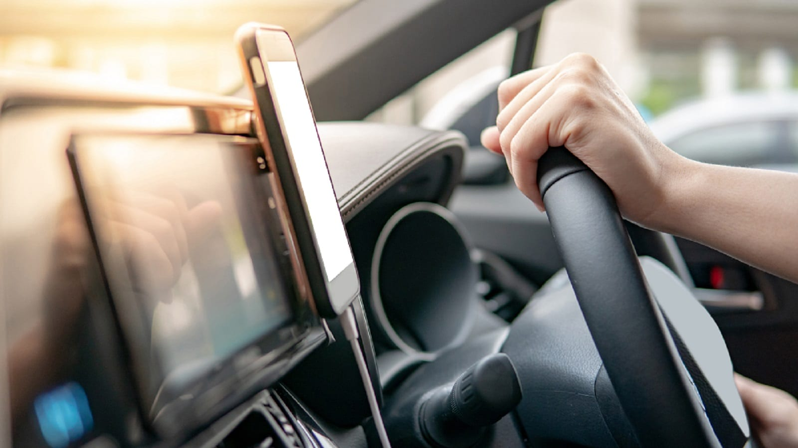 Mobile Device Supported On Dashboard Stock Photo