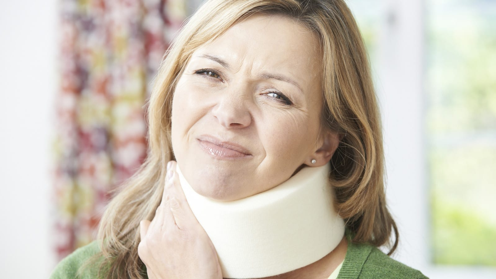 Mature Woman Experiencing Neck Pain Stock Photo