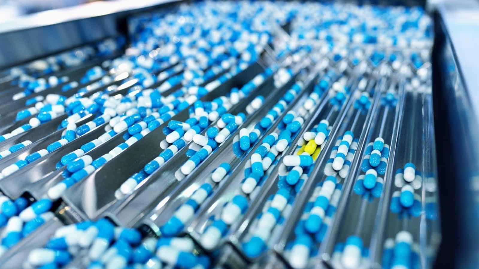 Prescription Pills Being Bottled Stock Photo