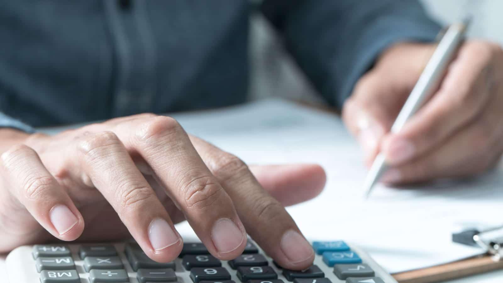 Man Using A Calculator Stock Photo