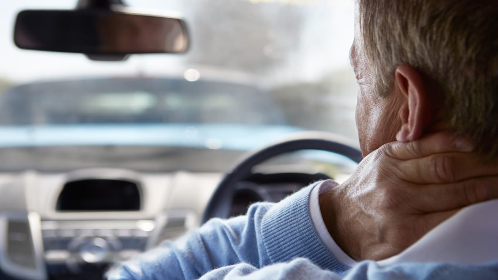Elderly Man With A Whiplash Injury Stock Photo