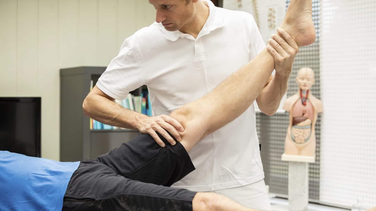Injured Man Having Leg Examined Stock Photo