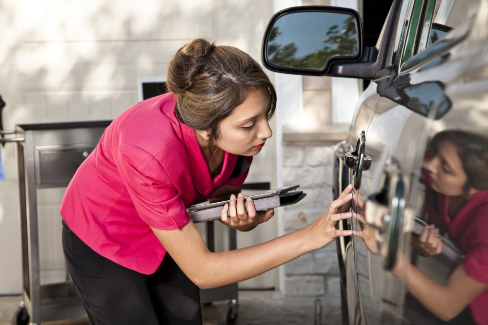 an insurance adjuster evaluating damage after a car accident